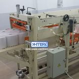 Automatic packing machine for jumbo rolls of toilet paper and towel